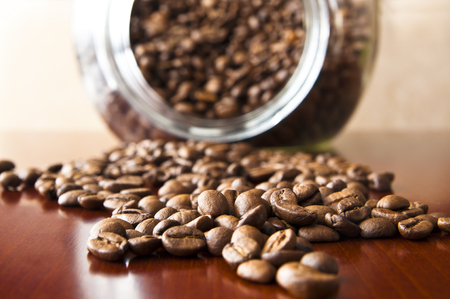 Coffee grain on a wooden table - coffee background