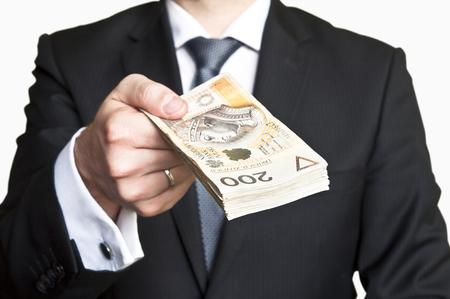 mucho dinero: Empresario llevaba traje y corbata de entregar una gran cantidad de dinero polaco