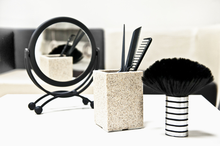 Hairdressers tools - a mirror, scissors, brush and combs Stock Photo