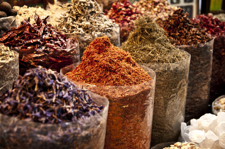 Oriental spice market - bags full of variety of spices: pepper, saffron and others Stock Photo