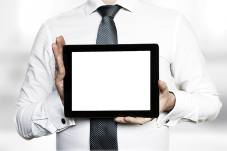 blank tablet: Man in shirt and tie holding a tablet computer with blank display