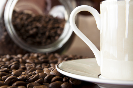 Coffee background - cup of coffee and roasted coffee grain Stock Photo