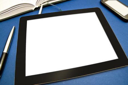 emty: Office equipment - a tablet with blank white screen, a mobile phone, a calendar and a pen on blue background.
