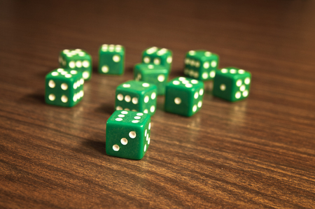 Dices on wooden table - game of chances