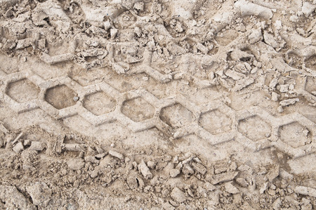 Tire trail on a dirt road pattern Stock Photo