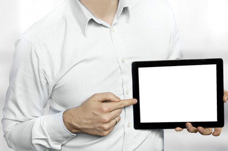 Man in shirt pointing finger at a tablet computer with blank display