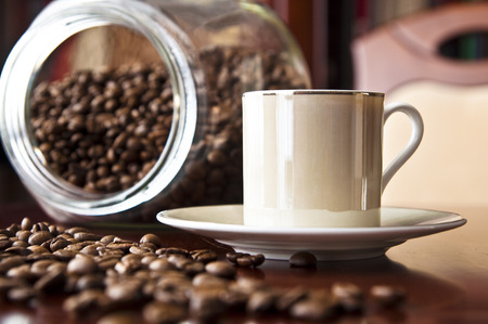 Cup of espresso and coffee grains. Coffee background. Stock Photo