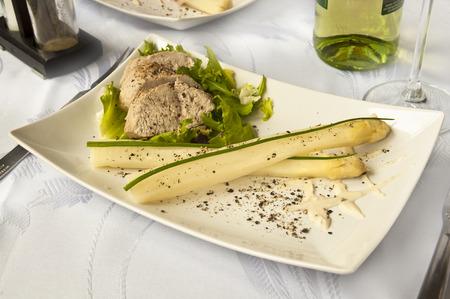 Tasty dinner - pork sirloin with asparagus and white wine