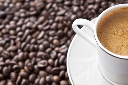Cup of espresso with foam on top. Coffee background with copy space. Stock Photo