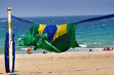 Beach volleyball field with Brazil flag at the Copacabana beach, Rio de Janeiro