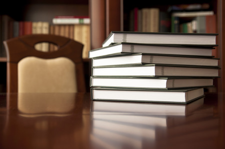 Good place for reading - bookstack on a wooden table