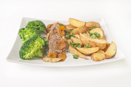 Tasty dinner - roast veal with fried potatoes and broccoli isolated on white background