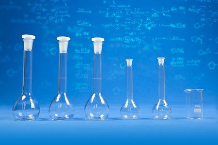 Chemistry bottles - blue scientific background