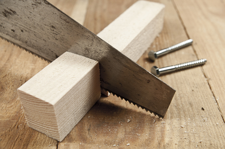 Carpenting hobby background - saw, screws and wood Stock Photo