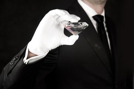 Big gem in hand of an elegant jeweler