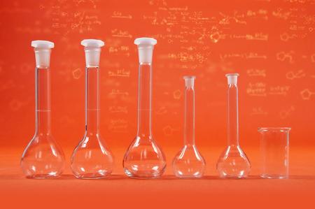 Chemistry science - flasks on orange background Stock Photo