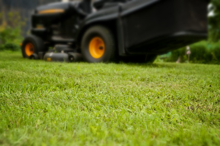 Mowing grass background, mower tractor, low depth of focus Stock Photo