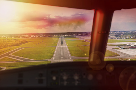 Final approach at sunset - view from the flight deck