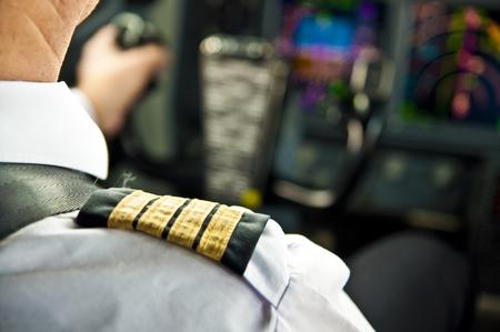 Captain epaulet on shoulder of a jet airliner pilot