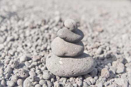 Stone pyramid in balance - monotone image