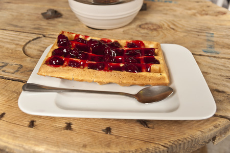 Sweet moment  - wafer with cherries on wooden table Stock Photo
