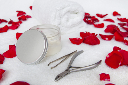 Manicure composition with rose petals - nail pliers, tweezers, cosmetics and towel