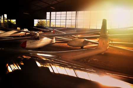 Hangar full of gliders at sunset - end of flying day at an aerodrome