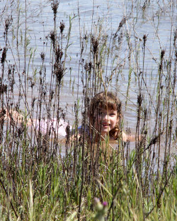 Girl hiding in the reeds