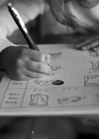 Child doing a work book Banque d'images