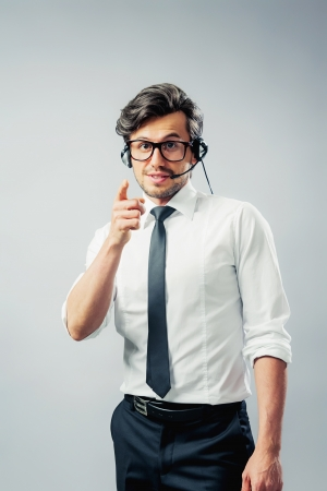 Man with headset pointing finger photo