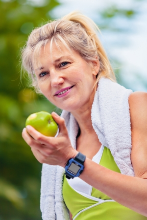 senior holds an apple