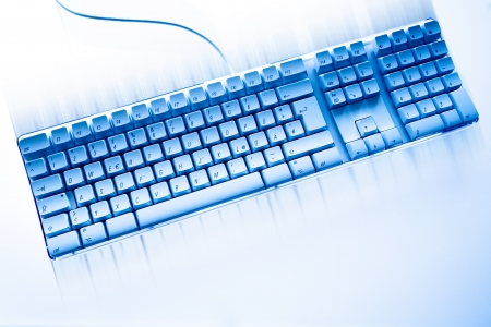 Computer keyboard in motion photo