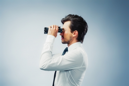 monitoring: business man with binocular
