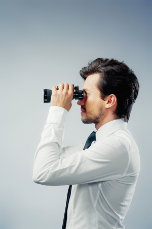 executive job search: business man with binocular