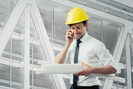 engineer with blue prints and cell phone