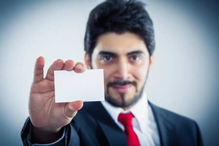 delightfully: Businessman showing his business card copyspace available