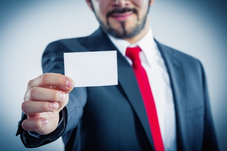Businessman showing his business card copyspace available photo