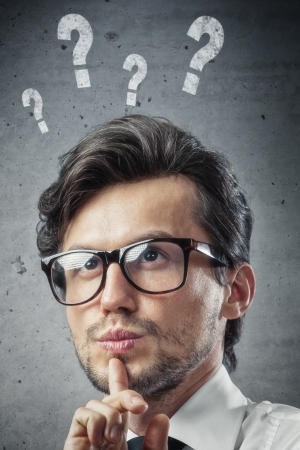 man with question marks over his head Stock Photo - 19561796