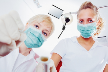 Dentist and dental assistant during an inspection  Stock Photo