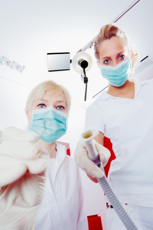dentist and assistant while work routine photo