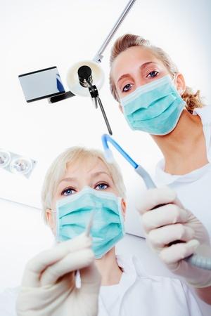 dentist and nurse working photo