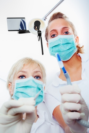 hygienist: dentist and nurse at work Stock Photo