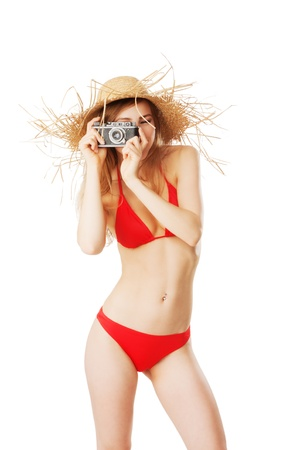 beautiful blonde woman in bikini taking pictures isolated on white Stock Photo