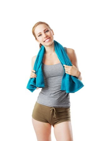 Sporty woman after fitness workout with blue towel isolated on white Stock Photo - 20572710