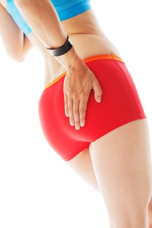 red panties: Rear view of a sporty woman in red panties testing her fitness with her hand