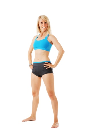sports wear: Blonde woman in sports wear looking to the camera isolated on white Stock Photo