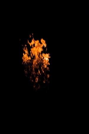Burning flame isolated on black photo