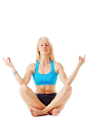 Blonde woman meditating isolated on white photo