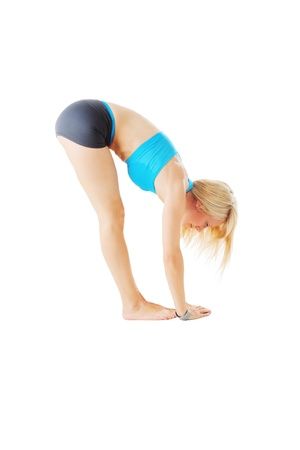 Blonde woman doing some stretching isolated on white Stock Photo - 20953176