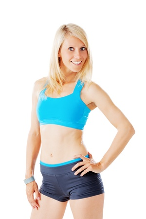 Blonde sporty woman in sports wear smiling to the camera isolated on white Stock Photo - 20953178